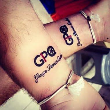 Tattoo of GPQ logo on two wrists
